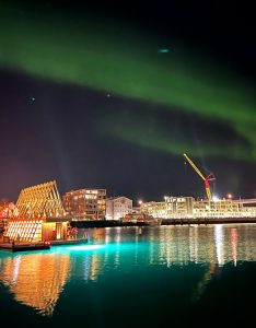 Build with treated wood, a luxury floating sauna in Tromsø Harbour, Norway, offers visitors views of the Northern Lights. Photos © David Jensen