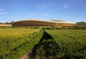 Zaha Hadid Architects' design for the all-timber Ecopark Stadium in Gloucestershire, England, has received approval by the English Football League. Rendering courtesy MIR