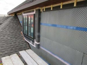 A rainscreen comprises the material, the type of channel and clip arrangement that are employed to fasten the veneer, the dimension of the air gap, the flashings and air- and water-resistive barrier.