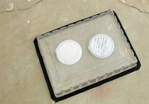 For the Calcium Chloride Test, a calcium chloride disk is first weighed, then placed under a sealed plastic sheet and left to collect moisture vapor. The disk is again weighed after 24 hours. The difference in weight indicates the amount of moisture vapor that emerged from the slab.