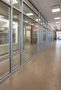 Epoxies are known for good adhesion, compressive strength, chemical resistance, and overall durability, all at a moderate cost.