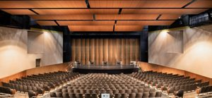 Gallatin High School, Bozeman, Montana, enhances viewing experience of various events in their auditorium by integrating a custom-designed acoustical shell system. Photo courtesy Staging Concepts