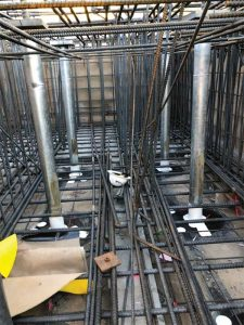 Figure 6: Waterproofing at base of steel trumpet within a large mat foundation reinforcing cage.