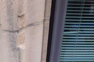 This spall at a window jamb unit does not require repair.