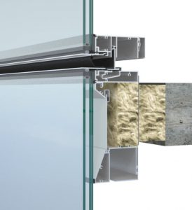 Glass curtain wall façade (left); detail of touch-mullion shadow box within unitized curtain wall.